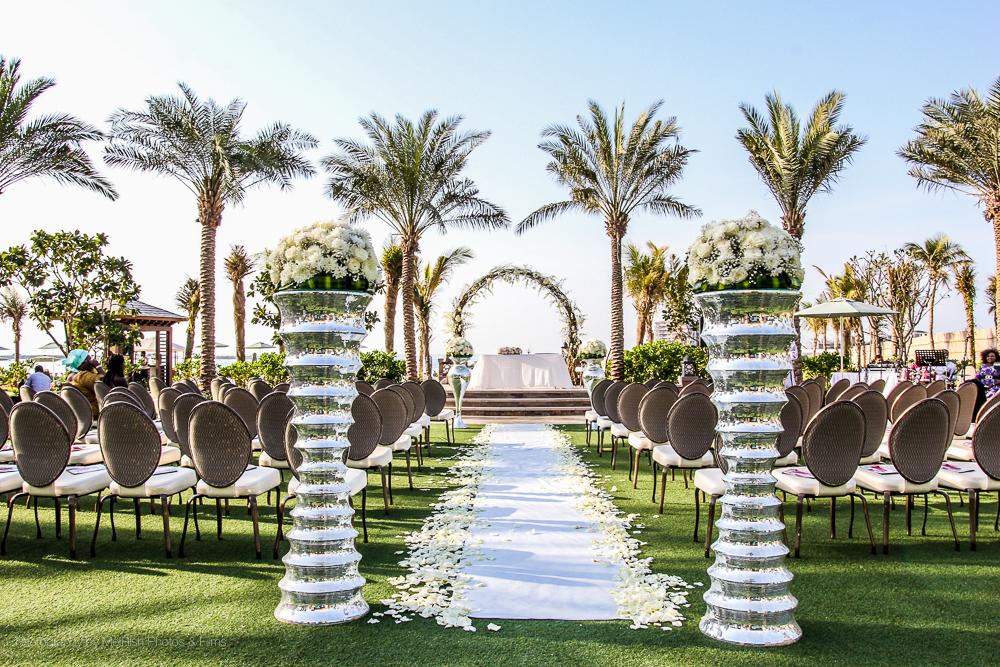 decor wedding flowers aisle dubai four seasons planner